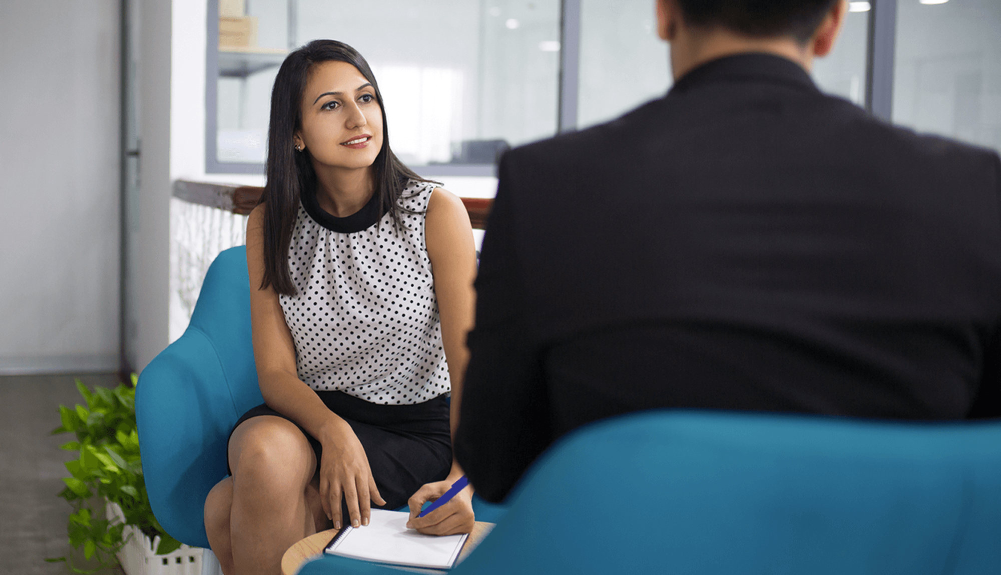 mature human resource management woman interviewing a person