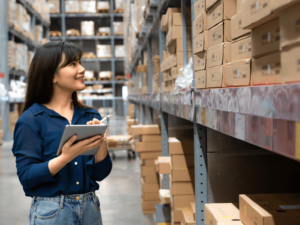 supply chain management operations manager performing inventory in a warehouse