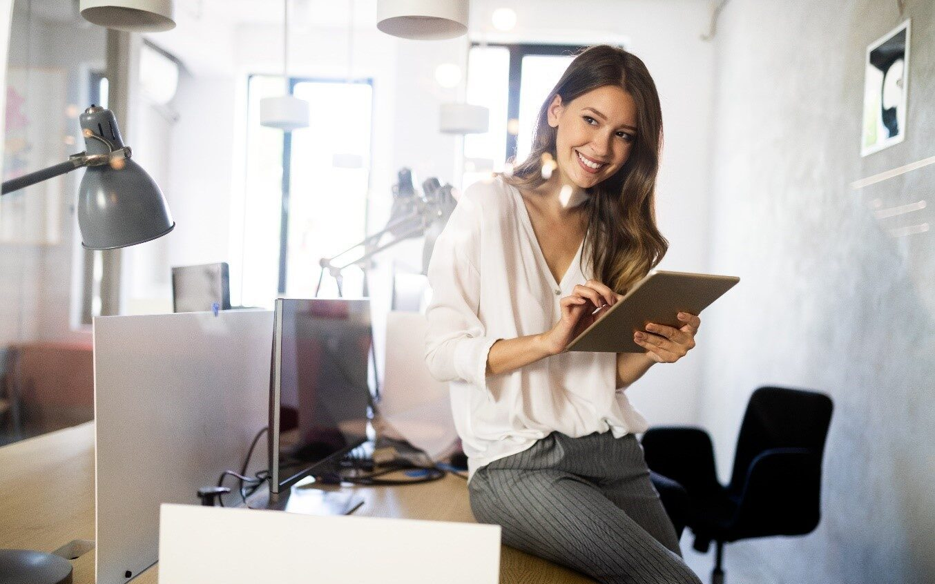 business management done by a woman leaning on a table