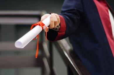 study business - graduate holding a certificate